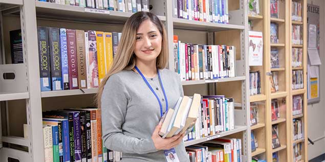 Happy Student inside Library