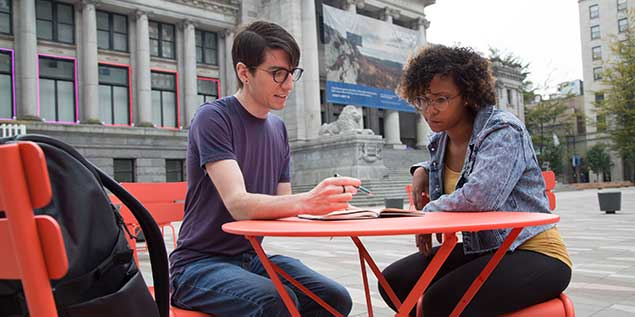 Student Mentor with Friend Outside Alexander College Campus