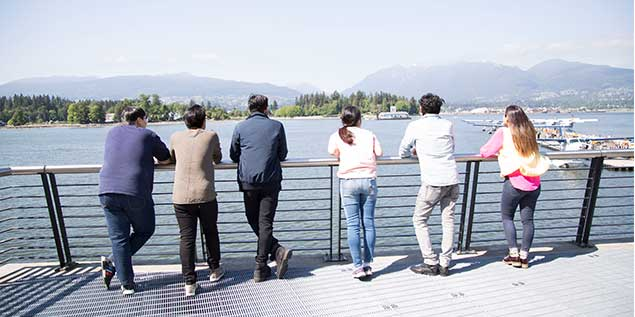 Group of Students Look Over Vancouver Horizon