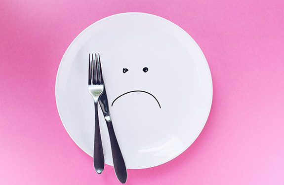 Plate with sad face
