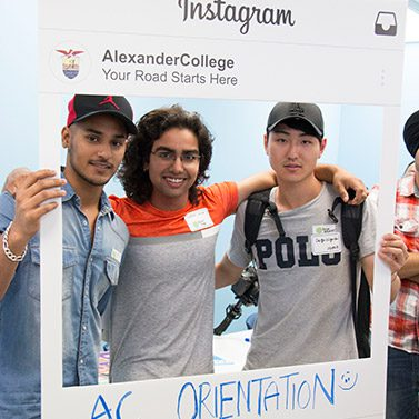 Students posing for the camera during Student Orientation at Alexander College