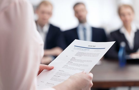 Employer reviewing student's resume during interview