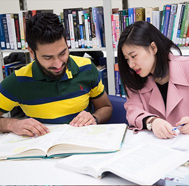 college students talking about lecture inside the library