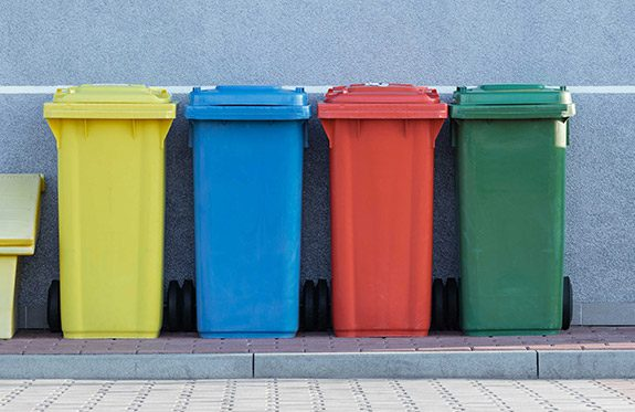 Colourful recycling bins to separate trash