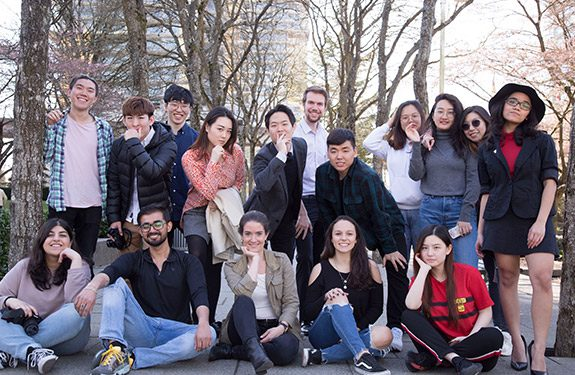 A group of happy international students posing at Alexander College Campus