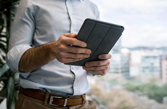 Student searching for jobs on tablet