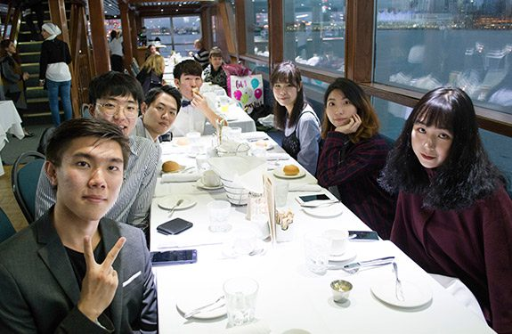 Group of Students Eating at a Restaurant in Vancouver Canada