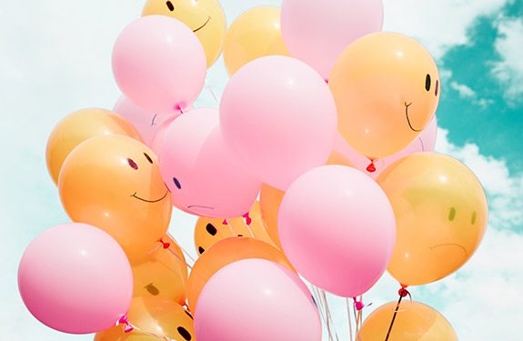 Balloons with happy smiles on them