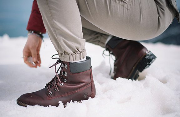Student wearing Timberland boots in snow