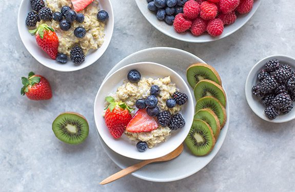Bowls of oatmeal topped with fruits showing healthy food options for Alexander College students