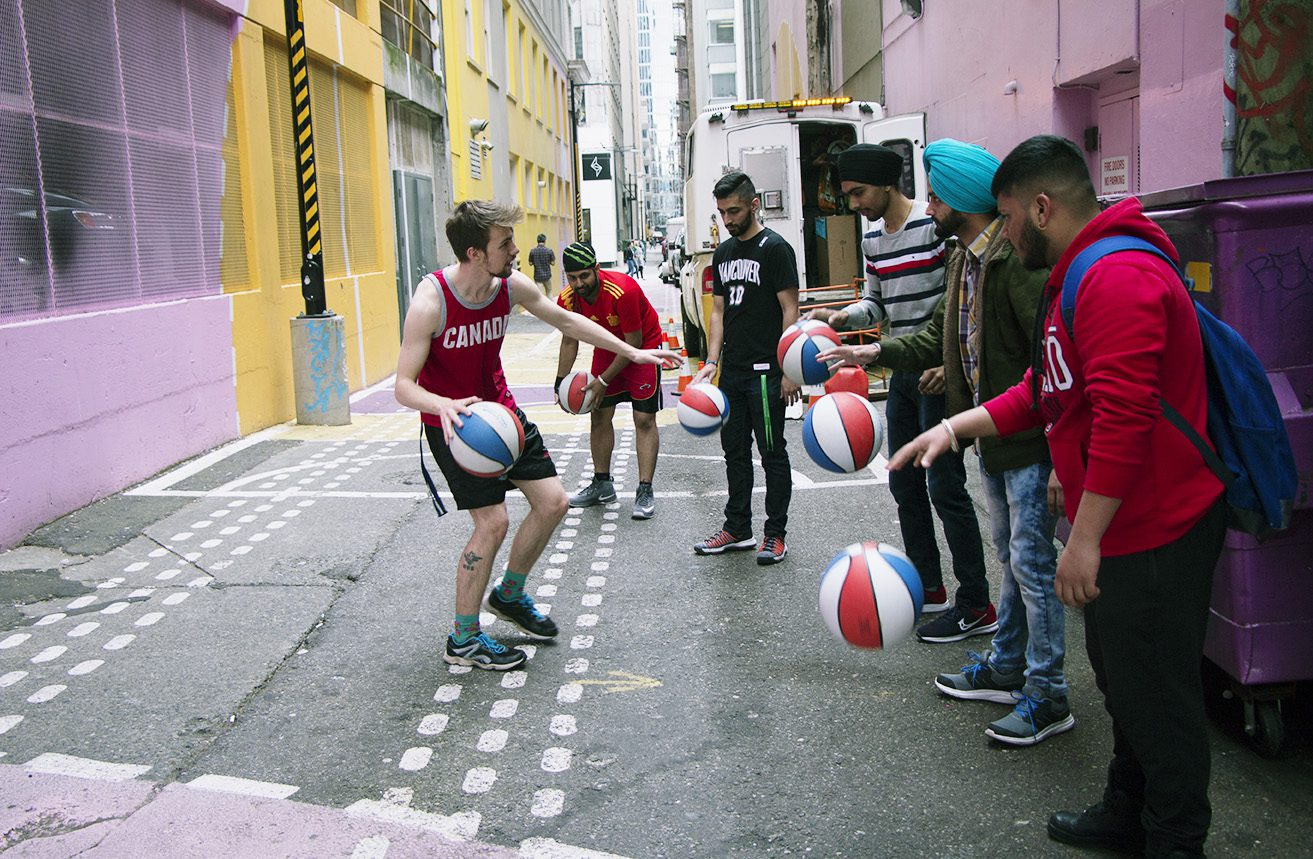 Student playing basketball after school
