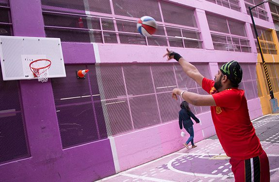 Student Playing Basketball After School for Fun
